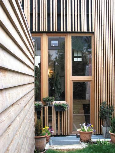 Extension en bois avec puits de lumière